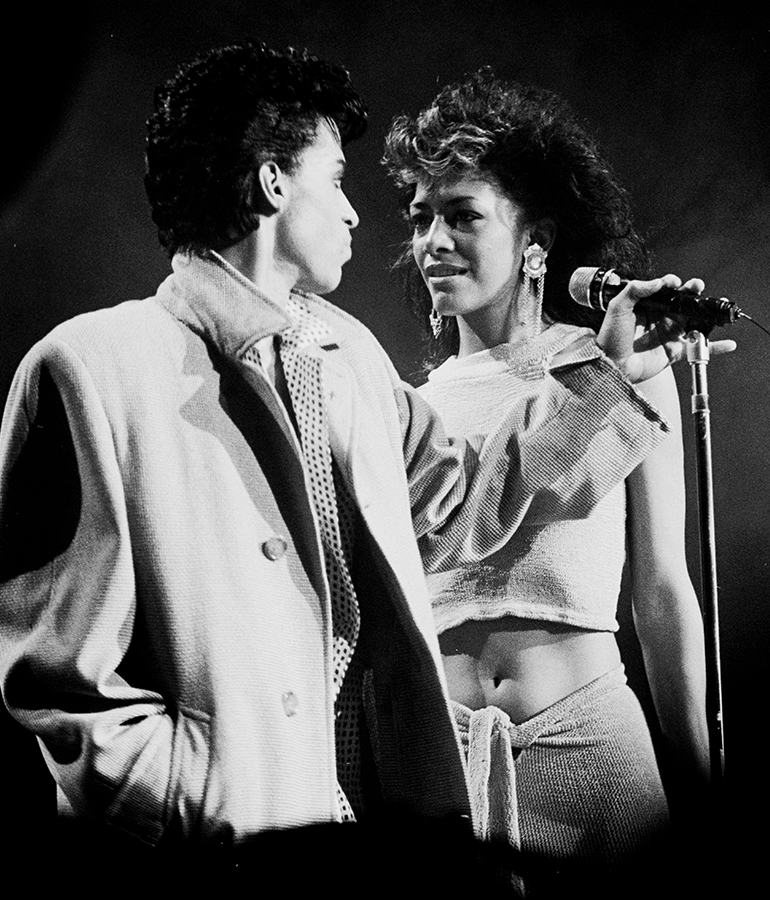 sheila e and prince at microphone black and white photo