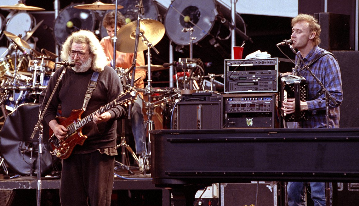 Bruce Hornsby playing accordion on stage with Jerry Garcia, both singing at mics, in 1991