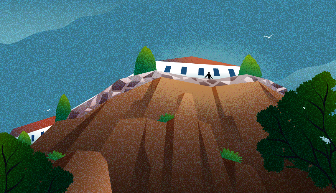 illustration of hotel perched on cliff and tiny silhouette of a person from far below