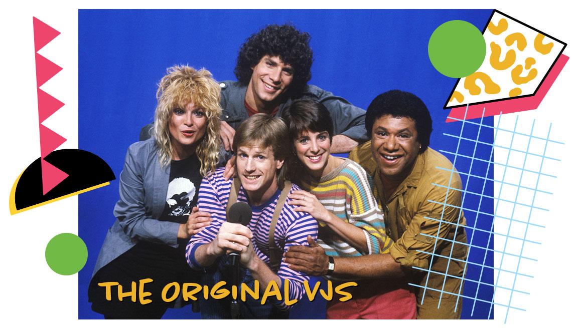 the five original MTV vjs Nina Blackwood, Alan Hunter, Martha Quinn, Mark Goodman, J.J. Jackson huddled together