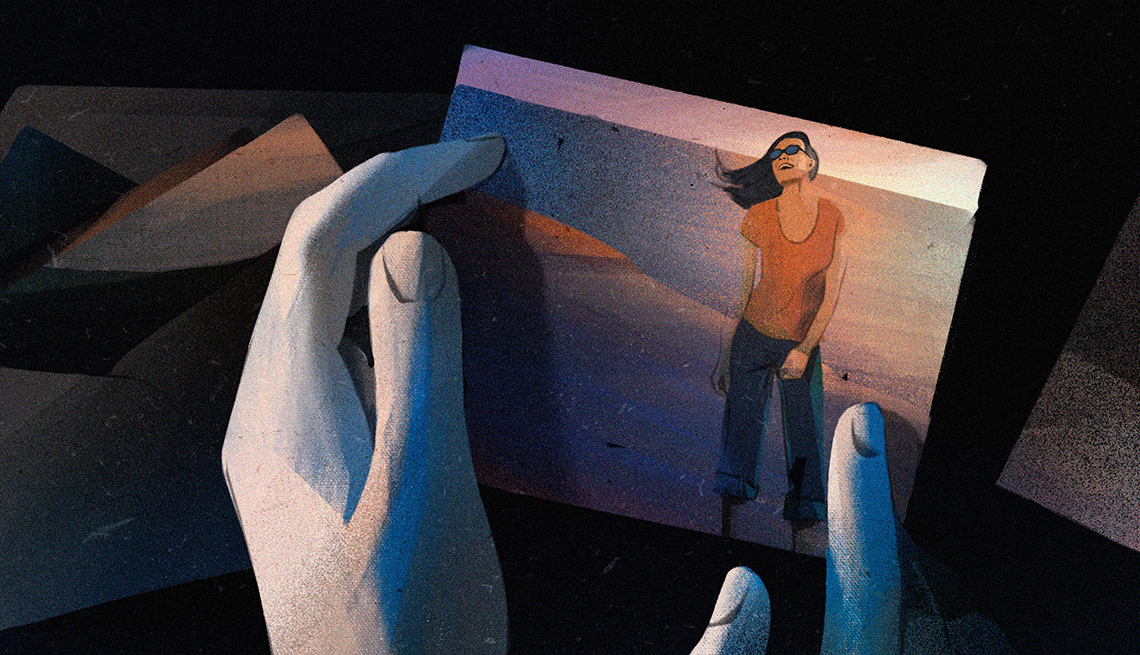 illustration of hands holding photo of a woman on a beach