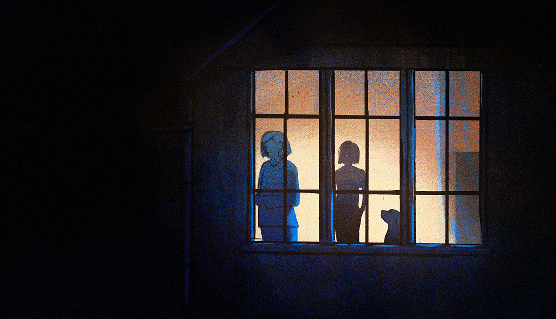 two silhouetted female figures and a dog standing inside by a window with darkness outside