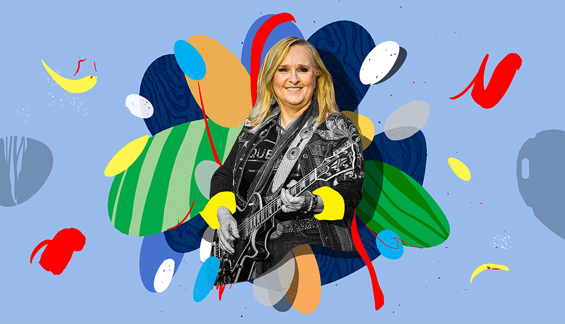 Melissa Etheridge playing guitar on a colorful background