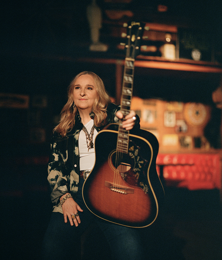 Melissa Etheridge holding her guitar