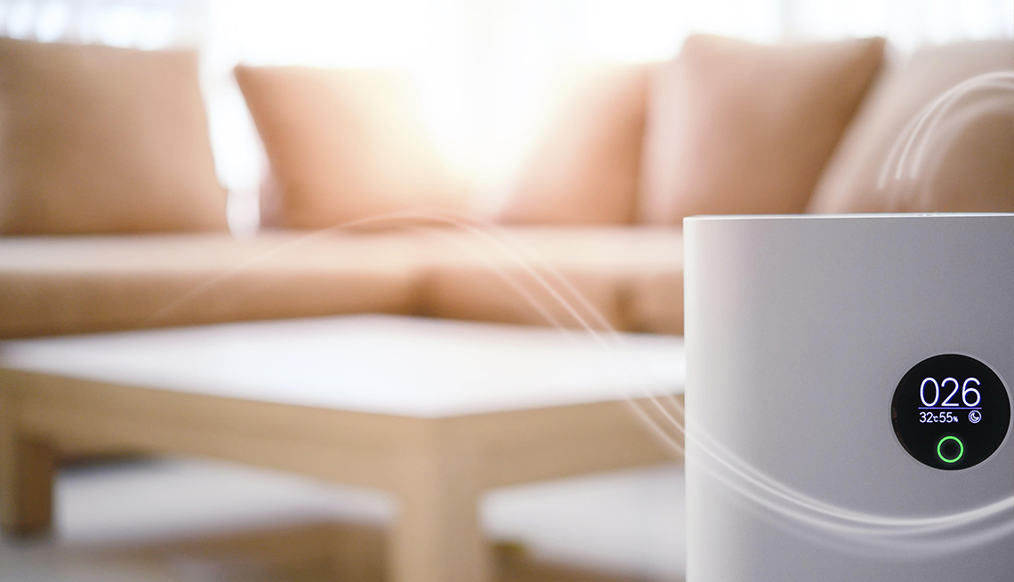 air purifier with couch and coffee table in background