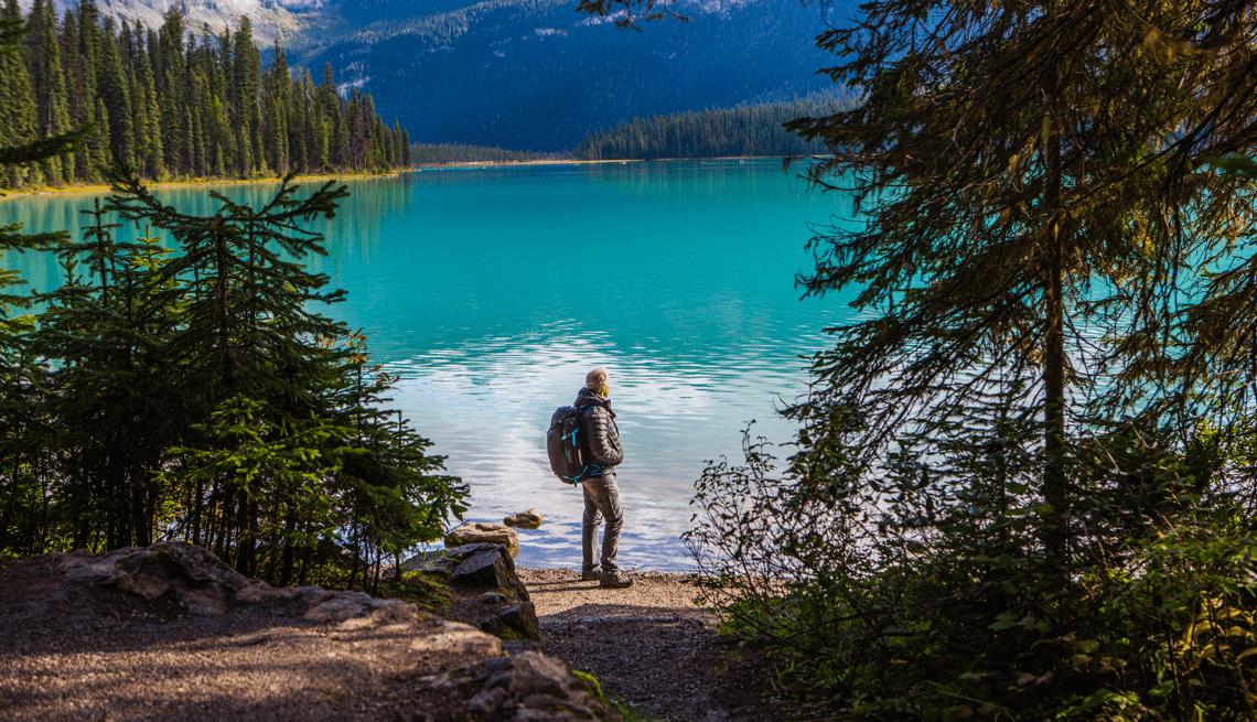Man hiking and overlooking lake Tahoe