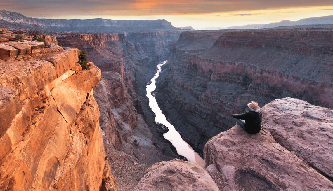 man overlooking the Grand Canyon