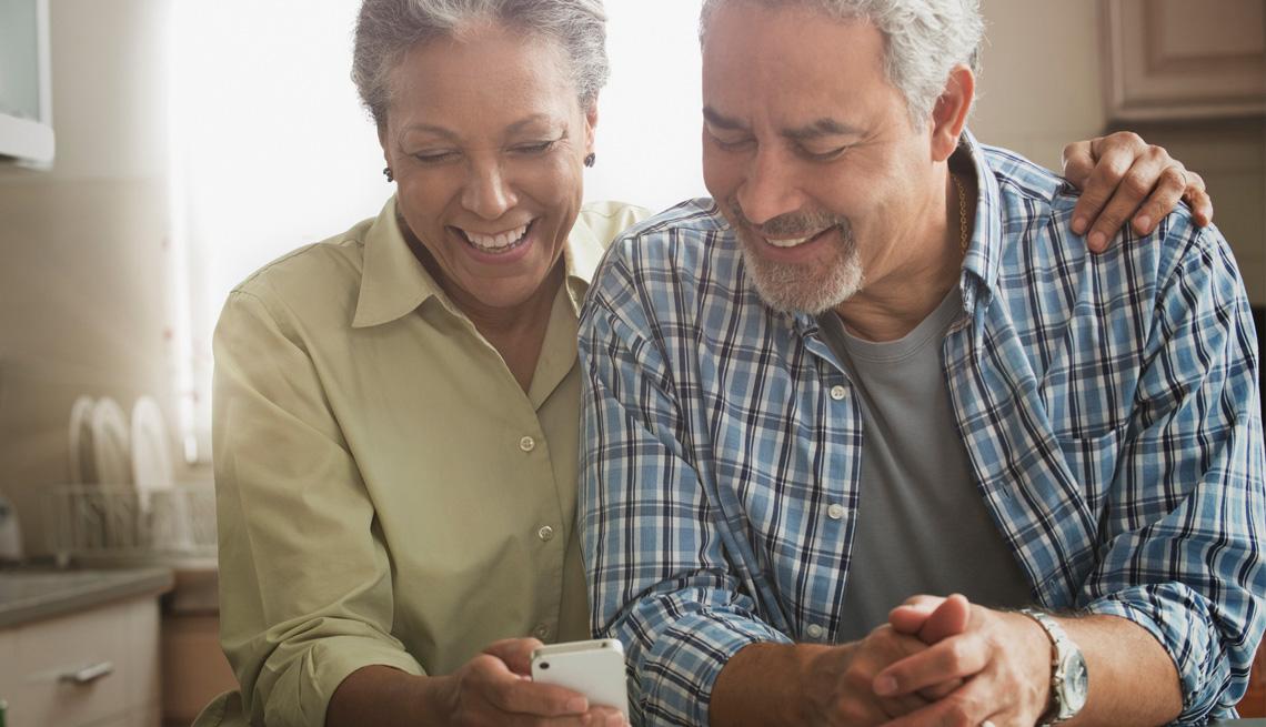 couple reading the AARP Bulletin