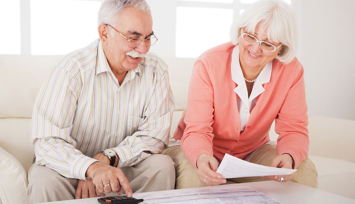 Mature adults filling taxes