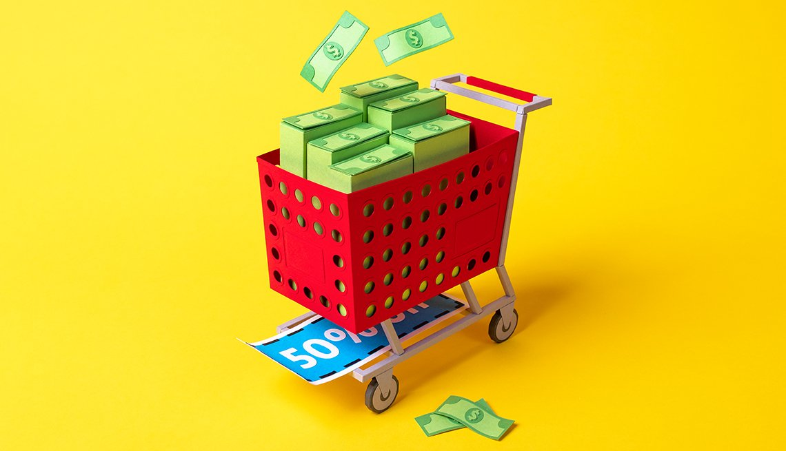shopping cart filled with dollar bills and sale signs
