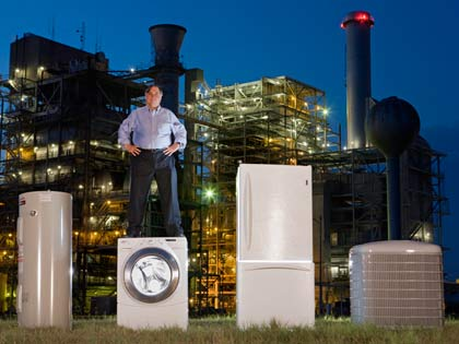 man standing atop energy efficient appliances