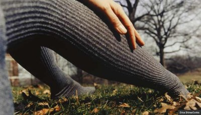 woman in pantyhose in meadow