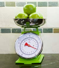green apples on a scale