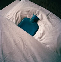 a hot water bottle in a bed