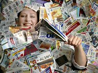 Janet Robinett, of Olathe, KS, pictured March 16, 2009 blanketed in coupons, teaches a BeCentsable workshop on frugal living.