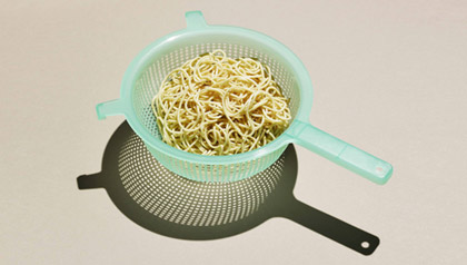 Weather will affect food prices, here is what to stock up on - pasta in strainer