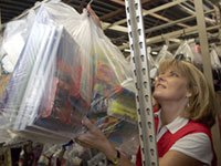 Tammy Wyatt, a layaway specialist at Kmart (photo by Nell Redmond/AP Photo)- Stores let customers make installment payments toward holiday gifts to avoid adding to credit card debt, but they will incur fees.