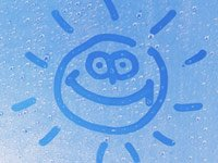 A sun happy face on water droplets - tricks to grow your savings account for a rainy day