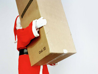 Free shipping is offered by many retailers for the holidays - photo of Santa Claus lifting heavy box