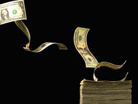 Dollar bills blowing-how to avoid outrageous hidden costs