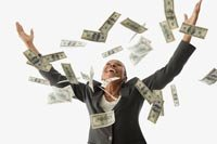 businesswoman throwing money in the air