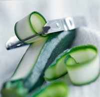 Peeled zucchini with peeler.