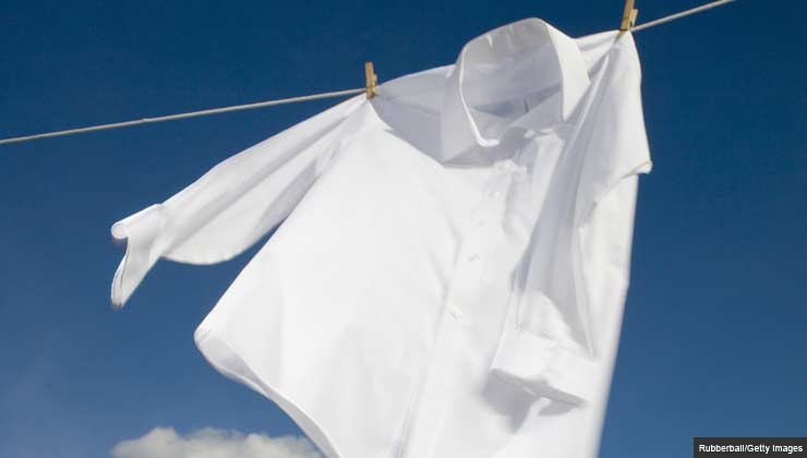 Shirt hanging on a clothesline outside.