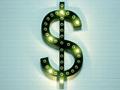 Signo de dólar encendido sobre pared de ladrillos