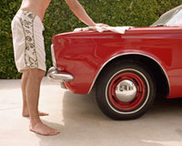A person washes an antique car 99 ways to save money