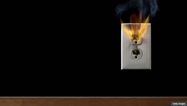 Electric wall socket on fire