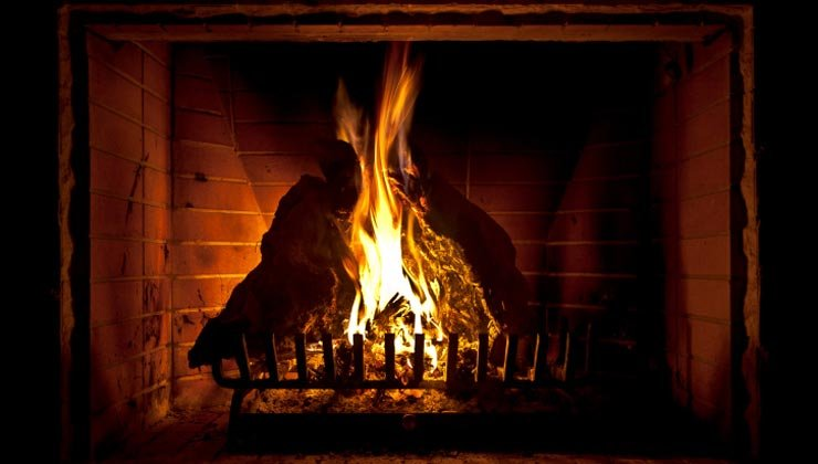 Roaring fire in fireplace