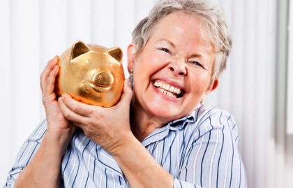 Happy adult woman holding piggy bank, Chatzky: Happiness and Finances