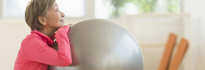 Woman exercising with fitness ball. 99 Ways to Save.
