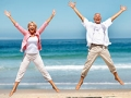 Mature couple jumps on a beach, Rules for making a splurge purchase