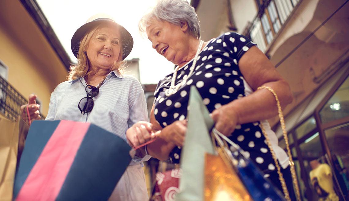 Below view of elderly women looking inside of shopping bags, JBQ Column January Retirement Spending