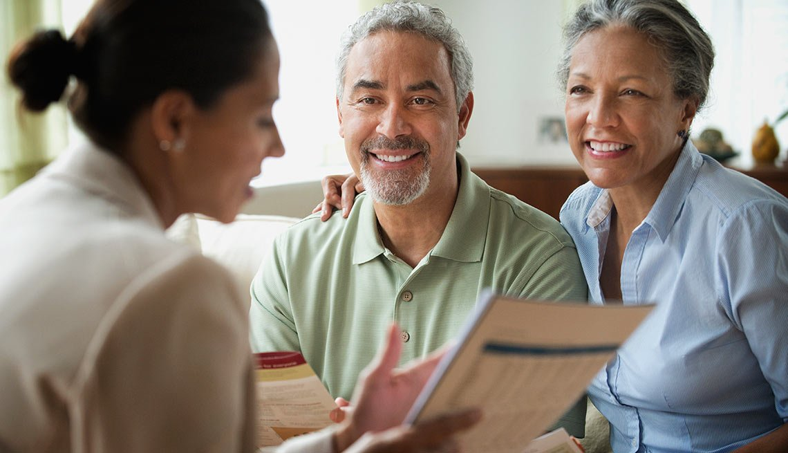 Mature couple learning about term life insurance