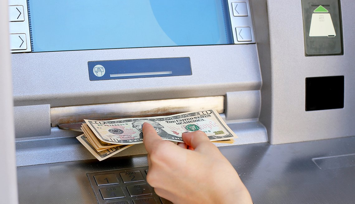 getting money from ATM machine,  Five Ways to Cut Nasty Banking Fees