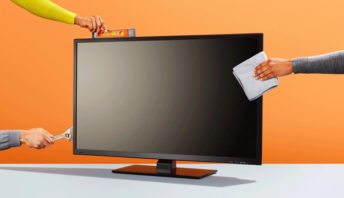 Imagen de un televisor con varios manos alrededor que sostienen herramientas y una libreta, como parte de las formas de ahorrar dinero