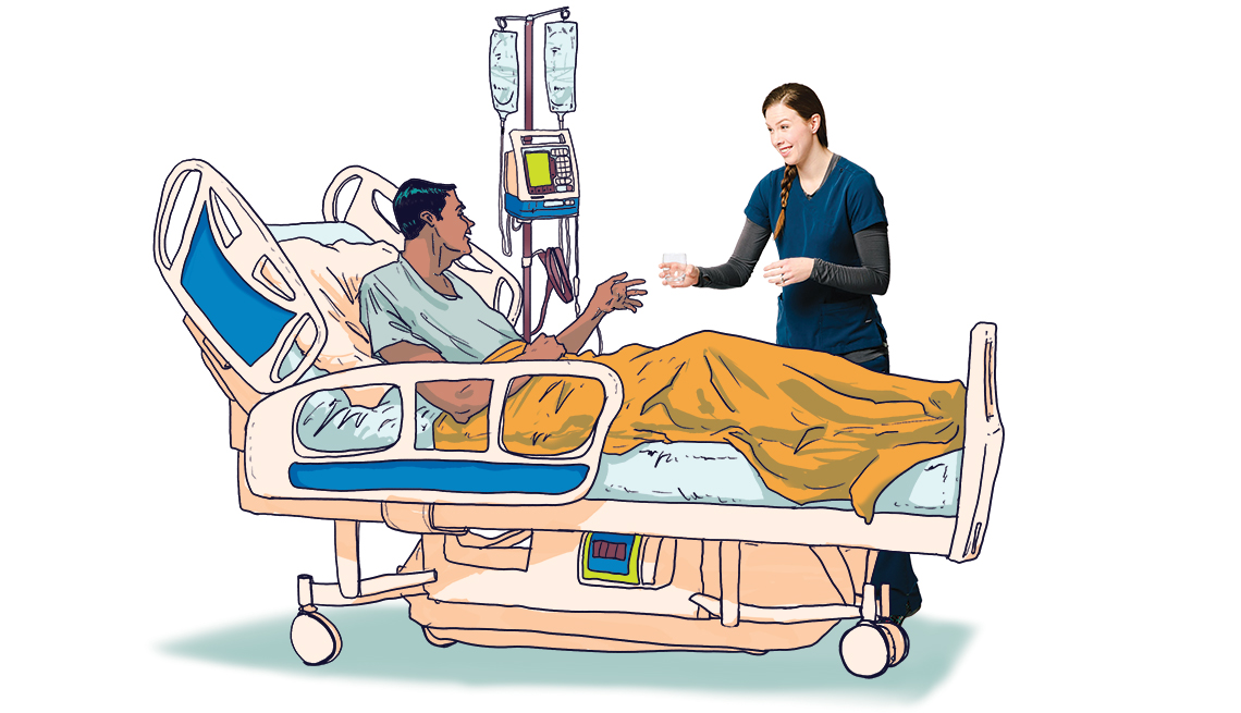 Nurse helps a patient in his hospital bed