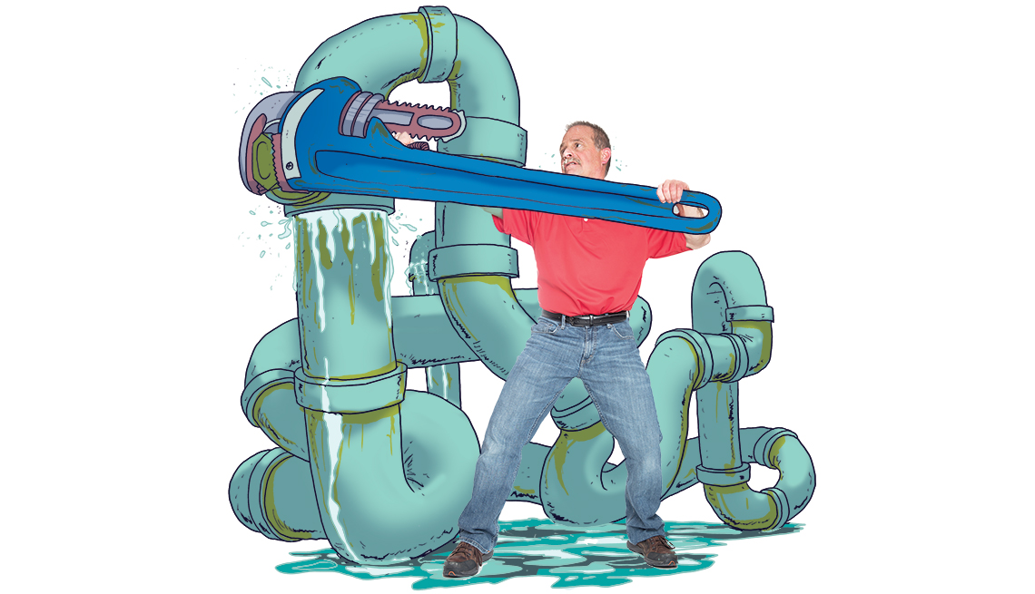 plumber fixes a giant pipe