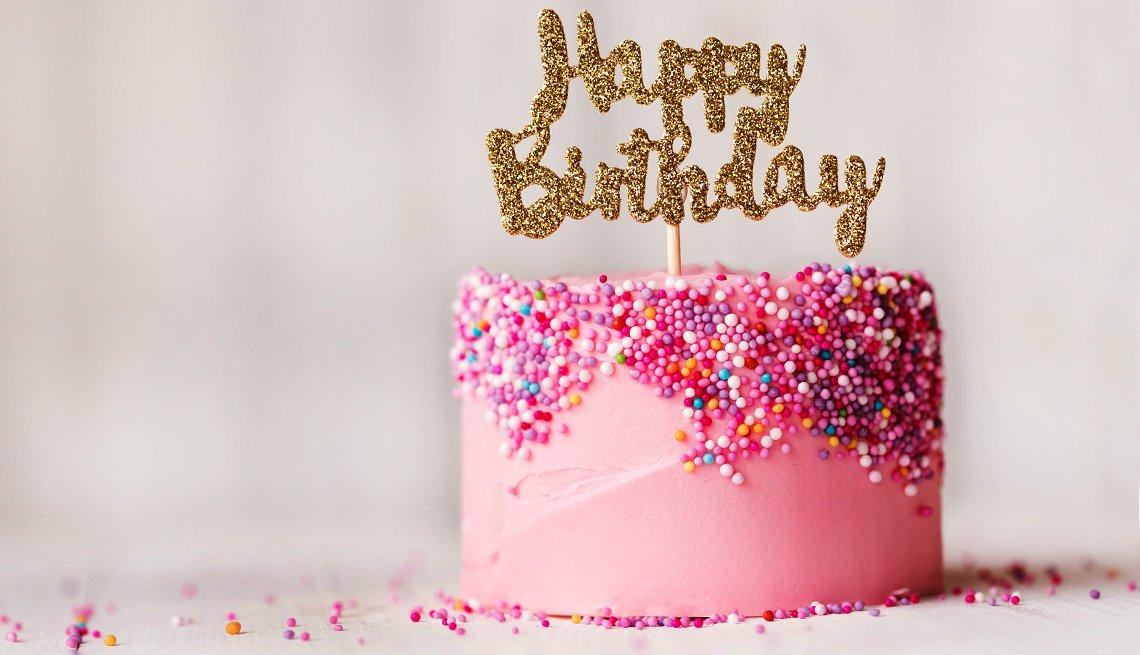 pink Birthday cake with happy birthday sign