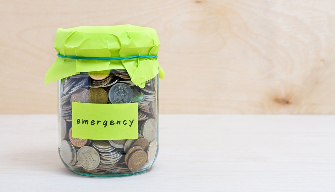 Change jar with emergency fund written on it