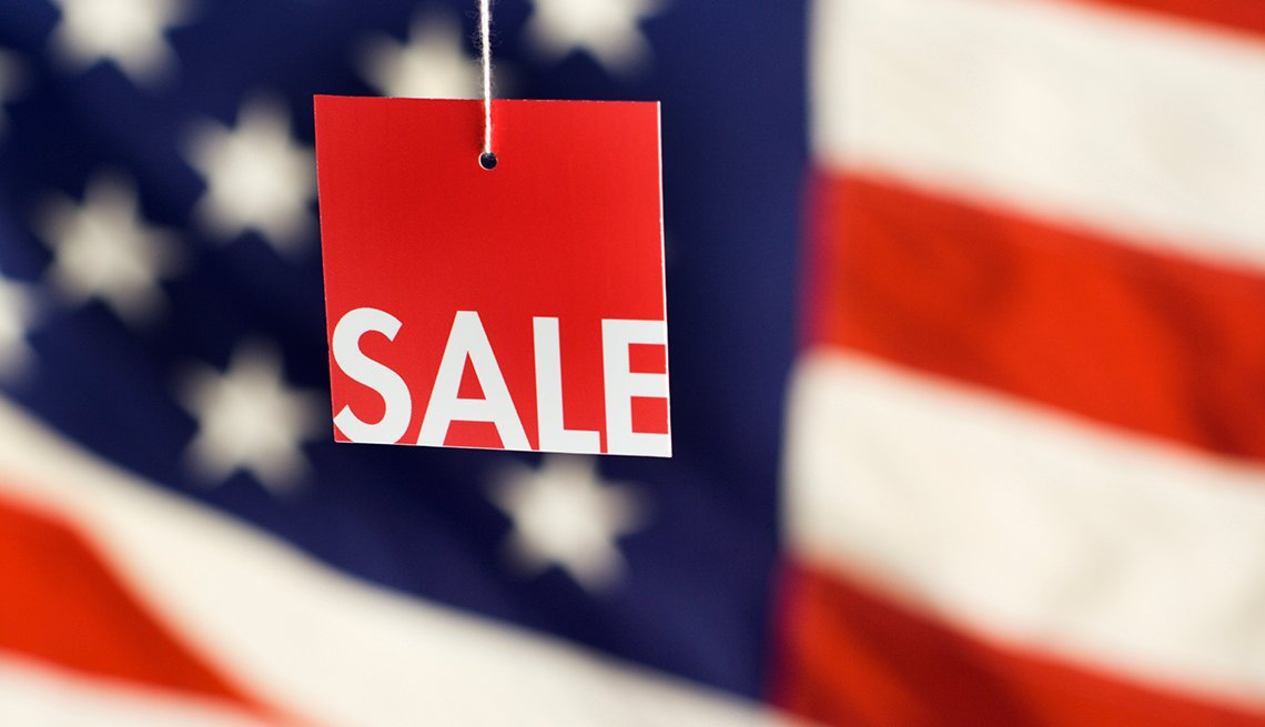 Sale tag hanging with American flag in the background