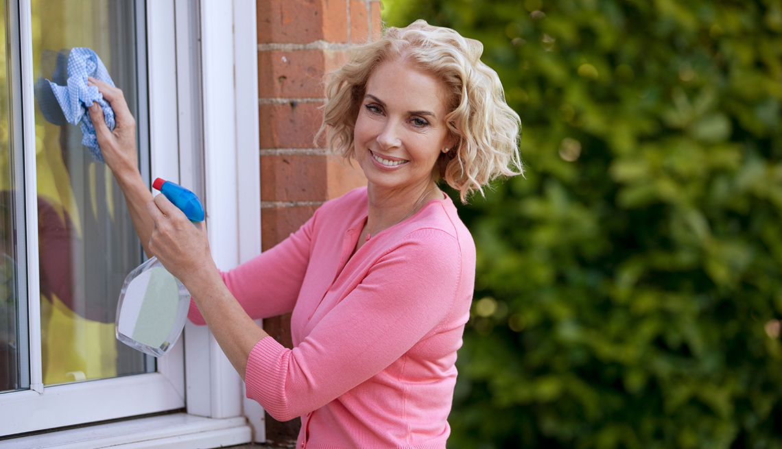 item 2 of Gallery image - Mature woman cleaning home windows