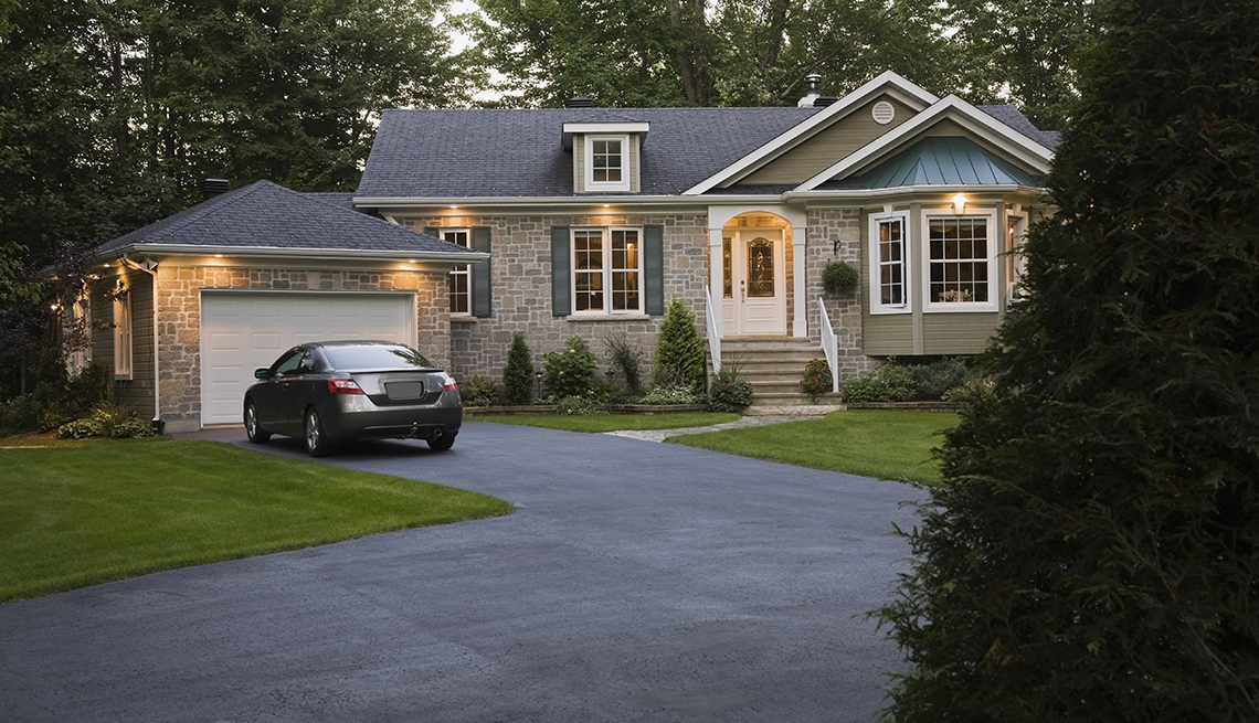 item 7 of Gallery image - Home at dusk with car in driveway