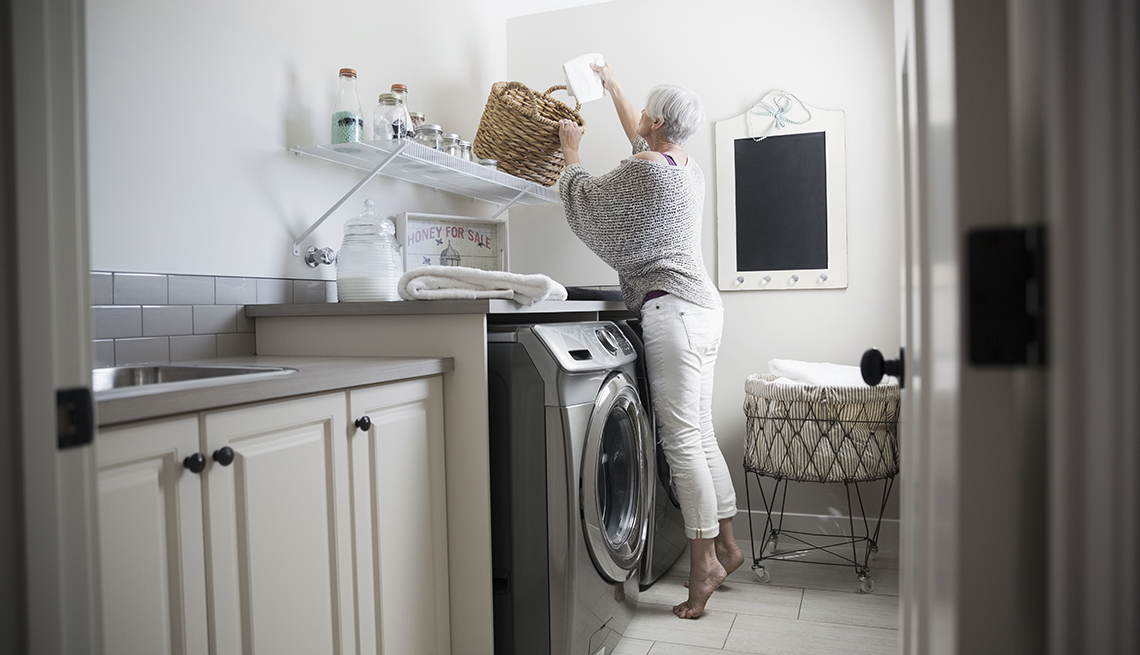 item 3 of Gallery image - Woman in laundry room