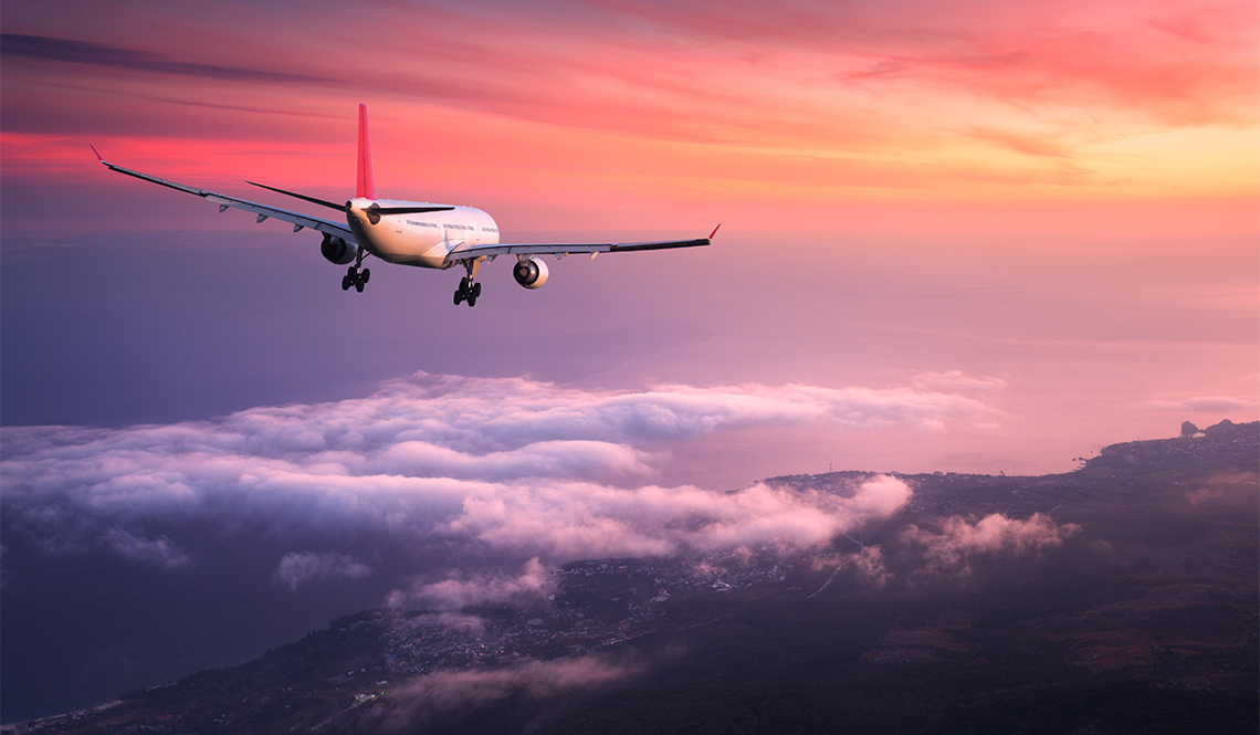 item 7 of Gallery image - Airplane flying above clouds at sunset