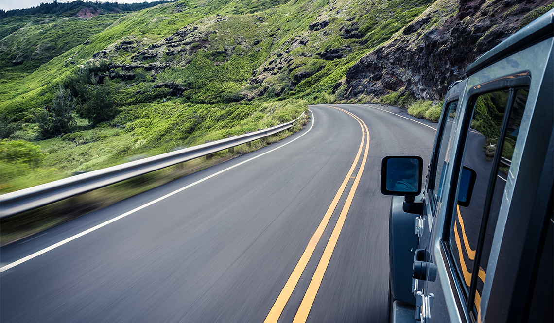 item 1 of Gallery image - Car going around a curve on a mountain highway