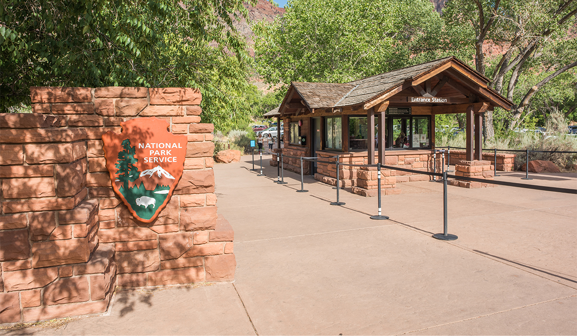 item 4 of Gallery image - National Parks sign at the entrance to Zion National Park
