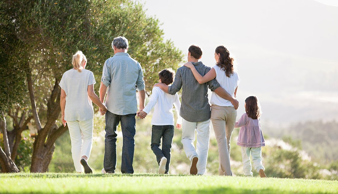 multi-generational family walking in a park